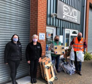 Colchester Foodbank volunteers collecting dollies donated by Evo Supplies